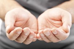 Two male hands as if giving, showing or holding concept Royalty Free Stock Images