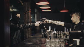 Two male hands with guns take aim at each other stock footage