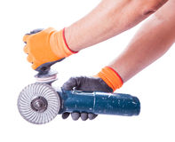 Two male hands holding circular saw Stock Photos