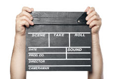 Two male hands holding movie production clapper board isolated Royalty Free Stock Photography