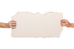 Two male hands holding piece of cardboard Stock Photography