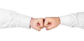 Two male hands in shirt as fists together isolated. On white Stock Image