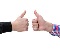 Two male hands showing thumbs up sign. On a  white background Royalty Free Stock Images