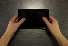 Two male hands are using tablet. Stock Photos