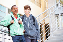 Two Male High School Students Standing Outside Building Stock Image