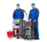 Two Male Janitors Standing With Cleaning Equipment. On White Background Royalty Free Stock Photos