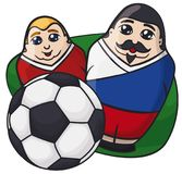 Male Matryoshka Dolls with Russian Colors behind a Soccer Ball, Vector Illustration. Two male matryoshka dolls painted like soccer players behind a soccer ball Royalty Free Stock Photo