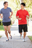 Two Male Runners Exercising On Suburban Street Royalty Free Stock Photo
