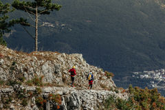 Two male runners on top mountain Stock Photos