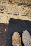 Two male shoe closeup on background of the old floor.  Royalty Free Stock Images