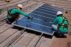 Free Two Male Solar Workers Install Solar Panels Stock Image - 35488971