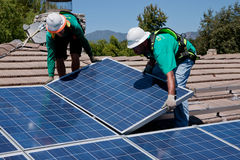 Free Two Male Solar Workers Install Solar Panels Stock Images - 35489234