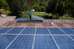 Two male solar workers install solar panels Royalty Free Stock Photography