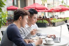 Two male student learning or entrepreneur working together. Two male student learning or entrepreneur working together Royalty Free Stock Images