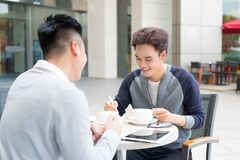 Two male student learning or entrepreneur working together. Two male student learning or entrepreneur working together Royalty Free Stock Photos