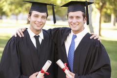 Two Male Students Attending Graduation Ceremony Stock Images