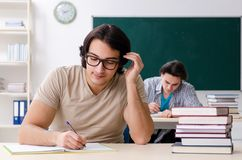The two male students in the classroom stock images
