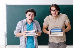The two male students in the classroom stock photos
