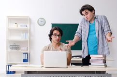 Two male students in the classroom. The two male students in the classroom stock photo