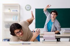 The two male students in the classroom stock image
