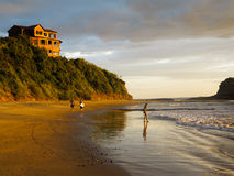 Free Two Male Surfers Walk On Beach Carrying Surfboards In Nicaragua At Low Tide Stock Images - 28369874