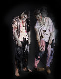 Two male zombies standing on black background, full length Royalty Free Stock Photography