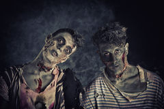 Two male zombies standing on black smoky background. Head and shoulder shot Royalty Free Stock Photo