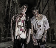 Two male zombies standing in empty city street Royalty Free Stock Photos
