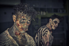 Two male zombies standing outdoor at night for Halloween Royalty Free Stock Images