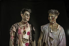 Two male zombies standing and smiling Stock Image