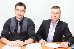 Two males sitting at the table Stock Image
