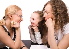 Two mams teach little girl isolated Stock Photography