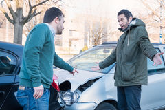 Two man arguing after a car accident Stock Photos
