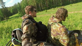 Two Man on ATV in forest video Selfe. Two Man on ATV in a forest video Selfe stock video