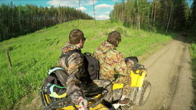 Two Man on ATV in forest video Selfe stock video
