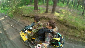 Two Man on ATV in forest video Selfe stock video footage