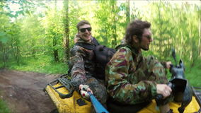 Two Man on ATV in forest video Selfe. Two Man on ATV in a forest video Selfe stock footage