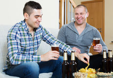 Two man with beer sit and talk Royalty Free Stock Photo