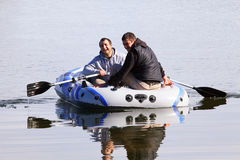 Two man in boat Stock Photo
