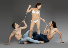 Two man on chain for woman - sexual games Royalty Free Stock Images