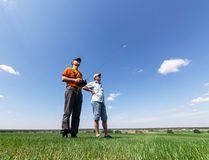 Two Man controls RC gliders Royalty Free Stock Photos