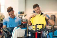 Two man deciding on new sportswear. Two men deciding on new sportswear in sports store Stock Photo