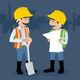 Two man doing construction work. Stock Photo