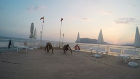 Two Man doing a handstand in pier stock video footage
