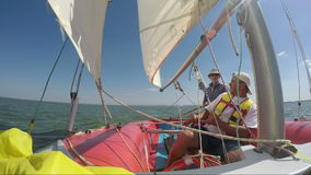 Two man drive a sport sailing yacht. Close-up view of the cockpit stock video