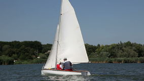 Two man drive a sport sailing yacht. In competition stock video footage