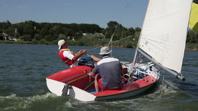 Two man drive a sport sailing yacht. In competition stock video