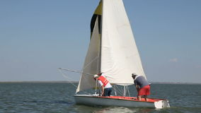 Two man drive a sport sailing yacht in competition. Sailing, sport, sail, yacht, team, regatta, boat, sailboat, race, yachting, competition, sea, ship, travel stock video