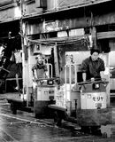 Two man. On the electric car in the fish market of Tokyo Stock Photo