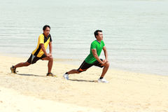 Two man exercise on the beach Stock Photography